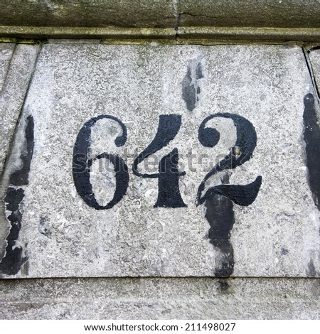 house number six hundred and forty two painted on natural stone - stock photo