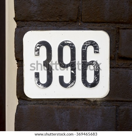 House number three hundred and ninety six, embossed in a metal plate. - stock photo