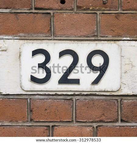 House number three hundred and twenty nine. - stock photo
