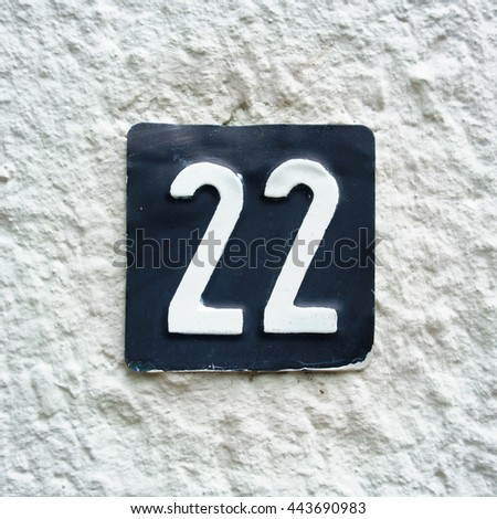 house number twenty two embossed in a metal plate - stock photo