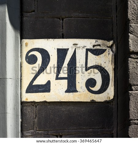 House number two hundred and forty five. - stock photo