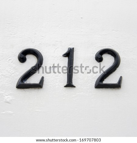 house number two hundred and twelve. Black numerals on a white background. - stock photo