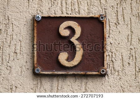 House numbers in different styles and colors (concept for real estate) - stock photo