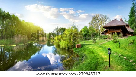 House of log near river in the morning - stock photo