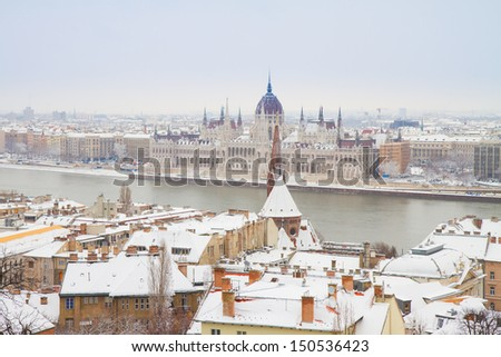 house of parliament over snowed roofs of Buda hill, Budapest, Hungary - stock photo