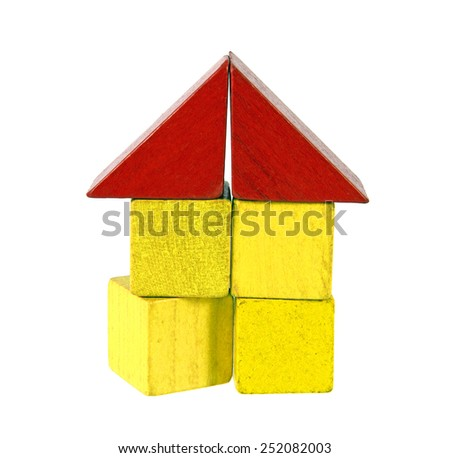 House of wooden blocks, traditional toy on white background - stock photo