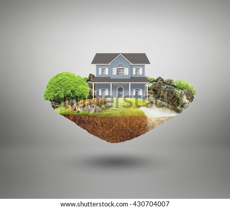 house on a piece of earth with garden - stock photo