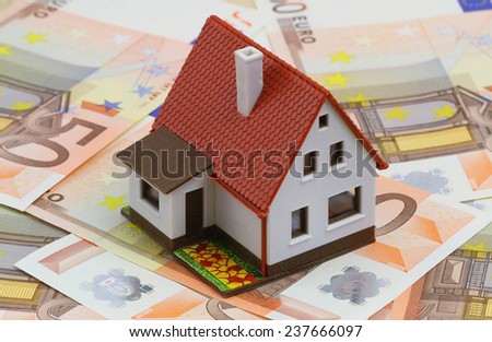 House on banknotes   - stock photo