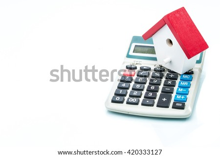 House on calculator, Mortgage Calculator, on white background - stock photo