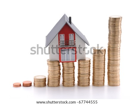 House on coins isolated on white background, mortgage concept. - stock photo