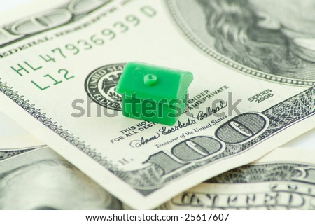 house on dollars - stock photo