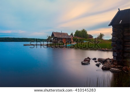 House on karelian lake long exposure night shot - stock photo