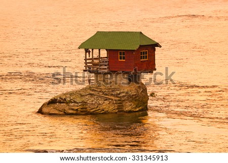 House on rock island in river Drina - Serbia - architecture travel background - stock photo