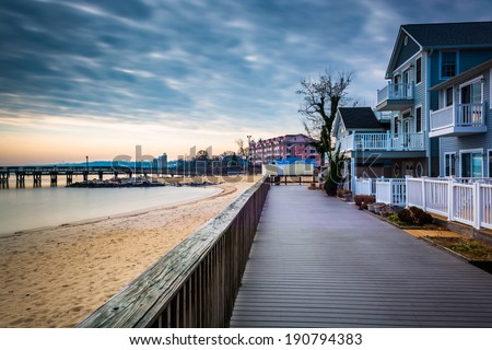 House on the boardwalk and the shore of the Chesapeake Bay, in North Beach, Maryland. - stock photo