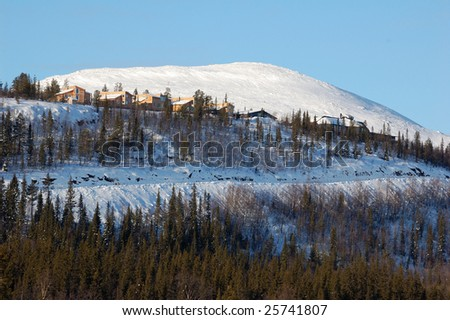 house on top of a mountain - stock photo