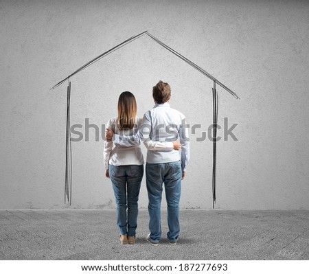 House project concept of a young couple - stock photo