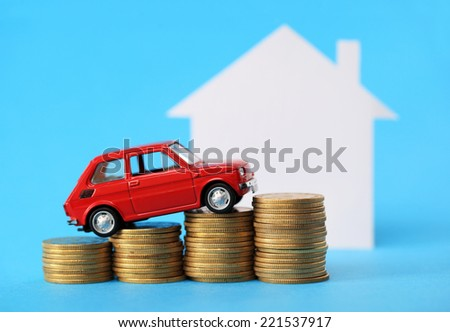 House, red miniature car and money - stock photo