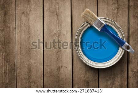 House renovation, paint can on the old wooden background with copy space - stock photo