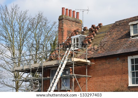 House Roof awaiting repair - stock photo