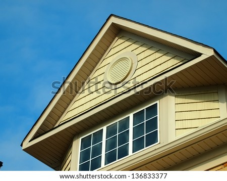 House roof in blue sky - stock photo