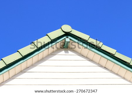 house  roof with blue sky - stock photo