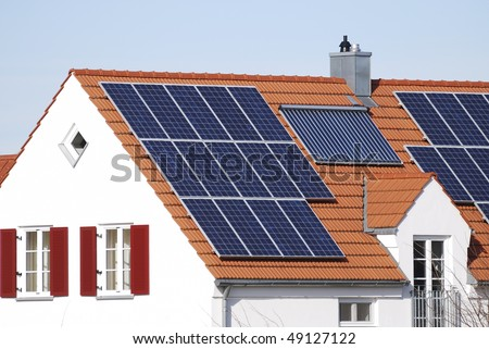House roof with regenerative energy system - stock photo