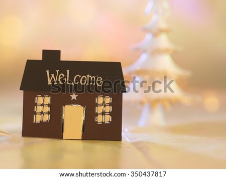 house shape light holder with christmas tree - stock photo