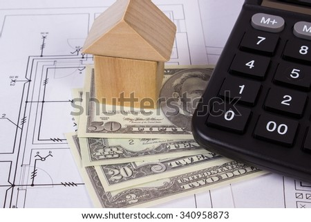 House shape made of wooden blocks, currencies dollar and calculator on electrical construction drawings of house, calculation of cost building house - stock photo