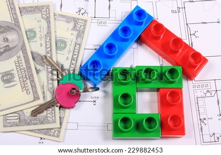 House shape of colorful building blocks, home keys and banknotes lying on construction drawing of house, concept of building house, drawings for projects - stock photo