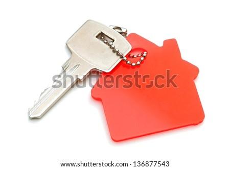 House shaped key chain isolated on white background - stock photo