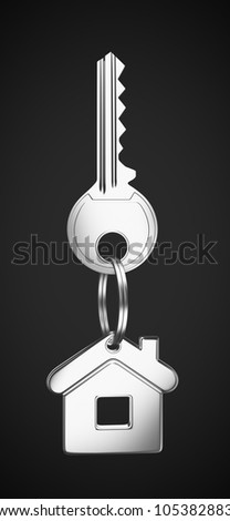 House shaped keychain on black background - stock photo