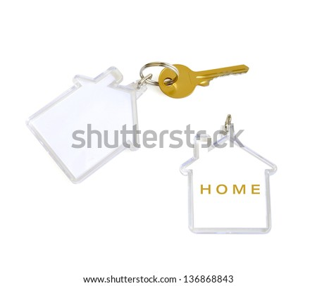 House shaped keyring giveaway with gold key - stock photo