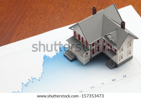 House sitting on graph. Concept of housing market.  - stock photo
