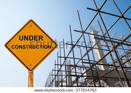 house structure with message under construction. - stock photo