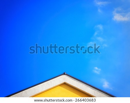 house top and blue sky with clouds - stock photo