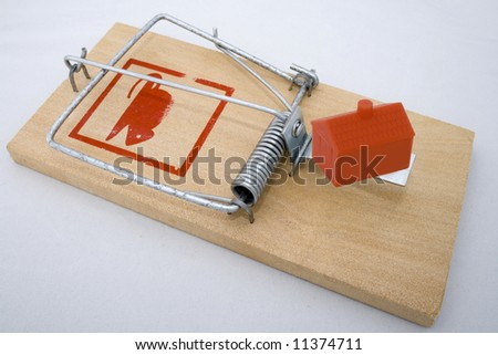 House Trap - house in a rat trap - stock photo