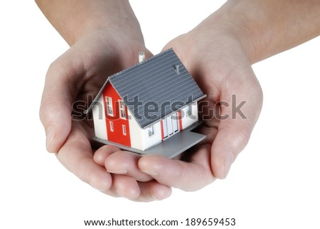 House under construction carried on hands - stock photo
