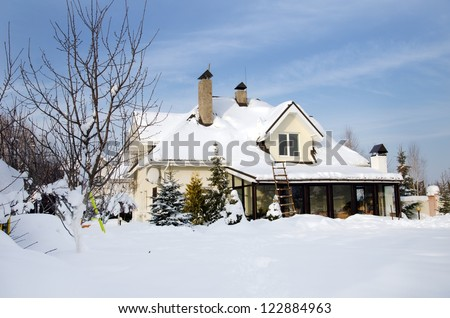 house under snow - stock photo