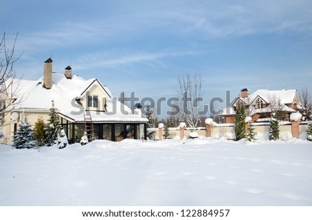 house under snow in winter with blue sky - stock photo