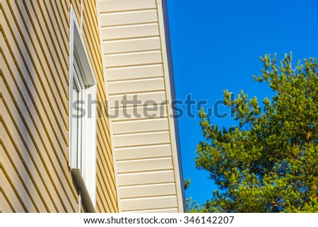House upholstered with siding. - stock photo