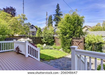 House walkout deck with stairs and backyard garden - stock photo