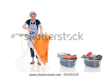 House wife, basket with ironed goods, daily household. - stock photo