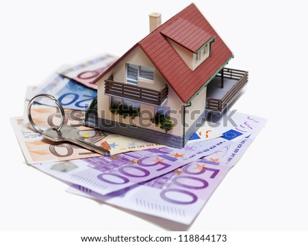 House with Euro banknotes and house key over white background - stock photo