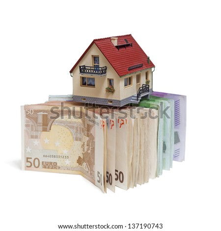 House with Euro banknotes on white background - stock photo