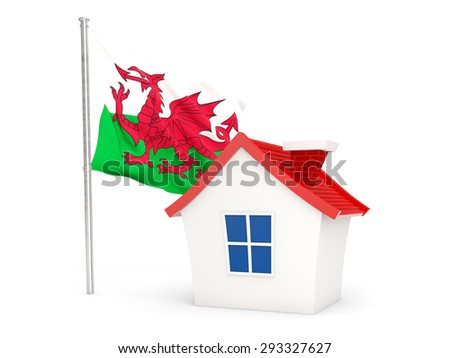 House with flag of wales isolated on white - stock photo