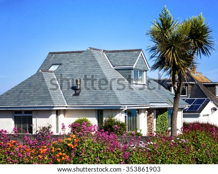 House with gardens in full bloom - stock photo