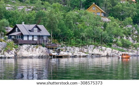 House with jetty and vegetation in the Lysefjord in Norway - stock photo