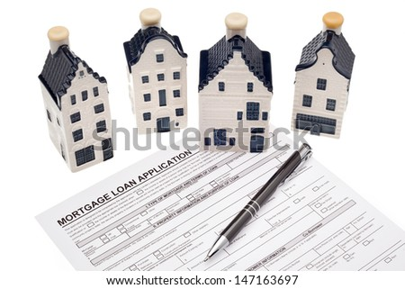 House with mortgage loan application - stock photo
