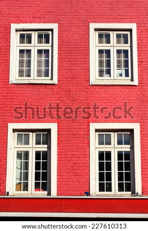 House with red facade - stock photo
