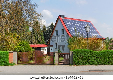 House with solar roof - stock photo